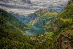 View of Geiranger. The Geiranger fjord in Norway, surrounded by high mountains Stock Image