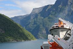 View of Geirangerfjord  Norway from rear of cruise ship Magellan with mountains to rear Royalty Free Stock Photography