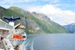 View of Geirangerfjord  Norway from rear of cruise ship turning with fjord in background Royalty Free Stock Photos