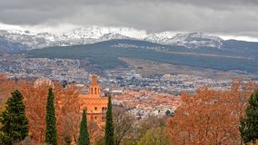 View on Generalife gardens and snow caps of Sierra Nevada mountains from the walls of Alhambra castle, Granada, Spain. View on Generalife gardens,city of Granada royalty free stock image