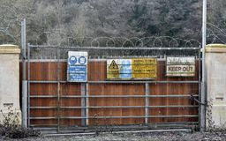 Warning and Keep Out Signs. View of Generic Warning and Keep Out Signs at a Construction Site Entrance Royalty Free Stock Image