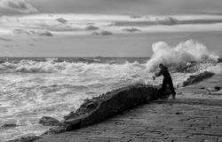 View of Genoa Boccadasse with rough sea during an autumnal day, Italy stock photos