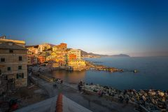 View of Genoa Boccadasse at sunset,  a fishing village with colorful houses in Genoa, Italy stock photos