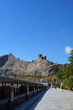 View of the Genoese fortress. Seafront town of Sudak. Crimea Royalty Free Stock Photo
