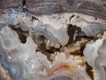 Raw Geode Close Up. View of a Geode after being cracked open. Love how the concave area, gives way to the crystals, and they reflect just enough sun.  Taken in Stock Photos