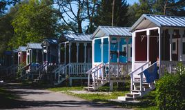 View of german camping place with tents, caravans, trailer park and cabin cottage houses. Germany stock photography