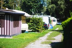 View of german camping place with tents, caravans, trailer park and cabin cottage houses Royalty Free Stock Photo