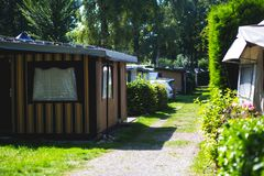 View of german camping place with tents, caravans, trailer park and cabin cottage houses Stock Images