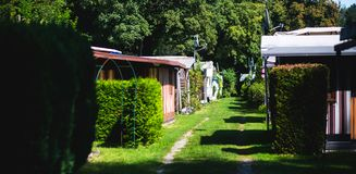 View of german camping place with tents, caravans, trailer park and cabin cottage houses Stock Photography