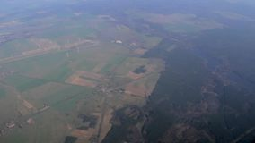 View of German countryside below on descent into Berlin schoenefeld airport Germany stock video