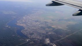 View of German countryside below on descent into Berlin schoenefeld airport Germany stock footage