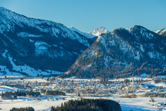 View of German village and Alps in winter Royalty Free Stock Photography