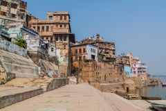 View of Ghats riverfront steps leading to the banks of the River Ganges in Varanasi, Ind. Ia stock image
