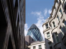 View of Gherkin building. In City of London from between old office buildings royalty free stock photography