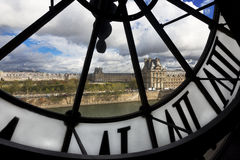 View through giant clock in Musee d` Orsay Stock Images
