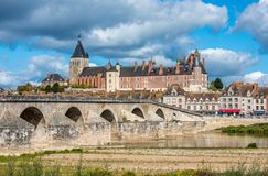 View of Gien with the castle and the old bridge across the Loire. River, France Stock Photos