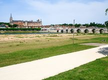 View of Gien city from valley of Loire river. Travel to France - view of Gien city from valley of Loire river in summer day Royalty Free Stock Images