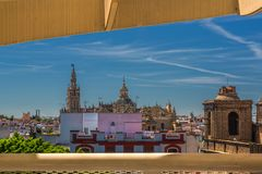 View of the Giralda and the Cathedral of Seville from Mushrooms Metropol Parasol, Seville, Andalusia, Spain. royalty free stock photo
