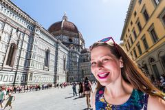 Girl in front of the Cattedrale di Santa Maria del Fiore in Flor. View of a girl in front of the Cattedrale di Santa Maria del Fiore in Florence Royalty Free Stock Photos