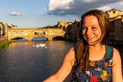 Girl in front of the Ponte Vecchio in Florence, Italy in summer Royalty Free Stock Photography
