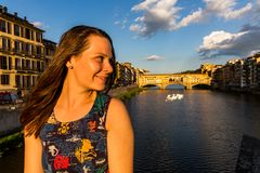 Girl in front of the Ponte Vecchio in Florence, Italy in summer Stock Photos