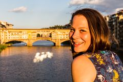 Girl in front of the Ponte Vecchio in Florence, Italy in summer Stock Photo