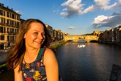 Girl in front of the Ponte Vecchio in Florence, Italy in summer Stock Photography