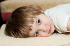 View. Girl lies on a bed Royalty Free Stock Images
