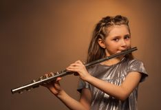 View of girl with long hair playing on flute Stock Images