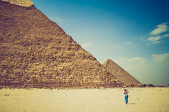 View of the Giza Pyramids and photographer tourist near them. Egypt. Cairo. Stock Photography