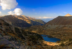 View of a glacial lake and the highest peak in national park Pirin, Bulgaria Royalty Free Stock Photo