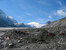 View on a glacier. View on the glacier of the grossklockner with warning signs Stock Images
