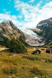 View at a glacier in Norway with cabins in the foreground royalty free stock images