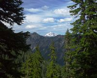 View of Glacier Peak (far perspective). View of Glacier Peak from the Blanca Lake Trail in the Cascade Mountains of Washington State royalty free stock photo