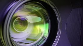 View of the glass elements in a camera lens. Objective under yellow light. Tilt-shift use. stock video