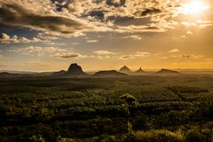 View of Glass House Mountains at sunset visible from Wild Horse Stock Photo