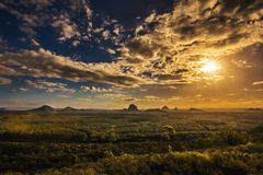 View of Glass House Mountains at sunset visible from Wild Horse Stock Photography