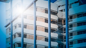 View of glass skyscraper reflecting the building around Royalty Free Stock Photos