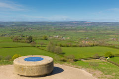 View from Glastonbury Tor of Somerset UK. Glastonbury Tor, Somerset, England, which features the roofless St. Michael's Tower. It is a Scheduled Ancient Monument Stock Photos