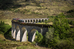 View at Glenfinnan Viaduct. Glenfinnan Viaduct in the summer and Hogwart Express passing over. Scotland Royalty Free Stock Images