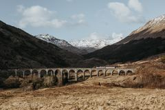 View of Glenfinnan Viaduct with a white train passing across, Glenfinnan, Scotland. royalty free stock photography