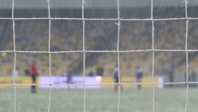 View of goal net during snowfalls stock video