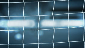 View of goal net with soccer pitch background stock video