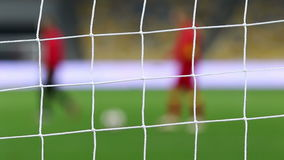 View of goal net with soccer pitch background stock video footage