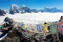 View from Gokyo Ri to Arakam Tse, Cholatse, Tabuche Peak, Thamserku and Kangtega with prayer flags Royalty Free Stock Images
