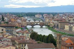 View of the Golden Bridge and the Arno River on a cloudy September evening. Florence, Italy Royalty Free Stock Images