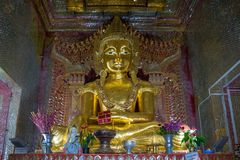 Mandalay Hill, Myanmar (Burma. View of a golden Buddha statue in one the many shrines along Mandalay royalty free stock photo