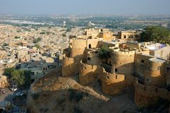View of golden city Jaisalmer surrounded by Thar desert Stock Photo