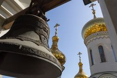 View of the golden domes from under the big bell. Donetsk, Ukraine - June, 16, 2019 year. View of the golden domes of the Trinity Ð¡athedral from under the big stock images