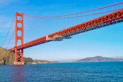 View of the Golden Gate Bridge from the boat . San Francisco, California, USA. Beach, blue, travel, sea, architecture, orange, reflection, city, tourism, ocean stock photos